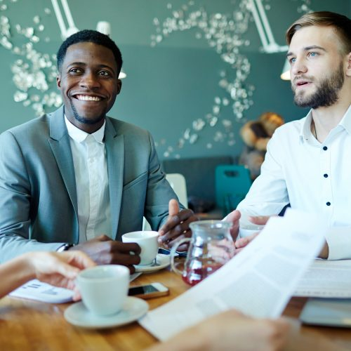 Successful employers talking to manager at briefing
